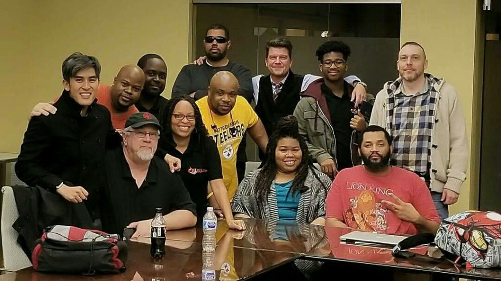 Photo of twelve members of the Universal Fan Con organizing team.